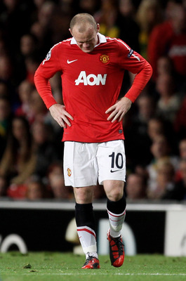 MANCHESTER, ENGLAND - SEPTEMBER 14:  Wayne Rooney of Manchester United grimaces in pain during the UEFA Champions League Group C match between Manchester United and Rangers at Old Trafford on September 14, 2010 in Manchester, England.  (Photo by Alex Live