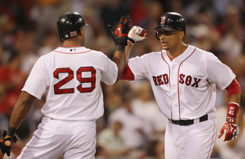 BOSTON - SEPTEMBER 08: Victor Martinez #41 of the Boston Red Sox is congratulated by teammate Adrian Beltre #29 after Martinez hit a solo home run against the Tampa Bay Rays on September 8, 2010 at Fenway Park in Boston, Massachusetts.  (Photo by Elsa/Get