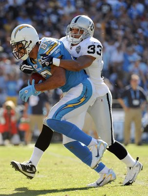 SAN DIEGO - NOVEMBER 01:  Vincent Jackson #83 of the San Diego Chargers is tackled by Tyvon Branch #33 of the Oakland Raiders during the game at Qualcomm Stadium on November 1, 2009 in San Diego California. The Chargers defeated the Raiders 24-16. (Photo