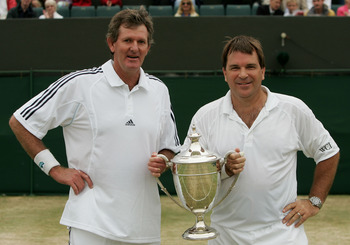 Kriek sharing a trophy with doubles partner Kevin Curran