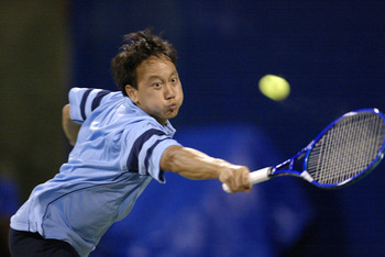 INDIANAPOLIS - JULY 21:  Michael Chang stretches out to return a serve at the baseline against Eric Taino during the RCA Championships at the Indianapolis Tennis Center July 21, 2003 in Indianapolis, Indiana.  Taino won 3-6, 6-3, 7-5.  (Photo by Brian Bah