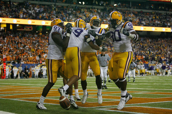 ATLANTA - DECEMBER 01: Jonathan Zenon #19 of the Louisiana State University Tigers celebrates after scoring a touchdown off an interception against the University of Tennessee Volunteers in the SEC Championship game on December 1, 2007 at the Georgia Dome
