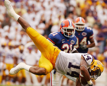 BATON ROUGE, LA - OCTOBER 11:  Michael Clayton  of the Louisiana State University Tigers makes a diving catch against the University of Florida Gators on October 11, 2003 at Tiger Stadium in Baton Rouge, Louisiana.  Florida would defeat LSU 19-7.  (Photo