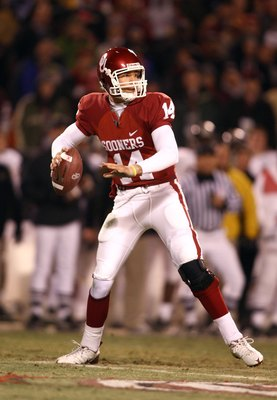 KANSAS CITY, MO - DECEMBER 6:  Quarterback Sam Bradford #14 of the Oklahoma Sooners sets up to make a pass play against the Missouri Tigers at Arrowhead Stadium on December 6, 2008 in Kansas City, Missouri. The Sooners defeated the Tigers 62-21.  (Photo b