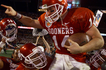 3 Jan 2001:  Quarterback Josh Heupel #14 of the Oklahoma Sooners is hoisted by his teammates after defeating the Florida State Seminoles 13-2 in the Orange Bowl at Pro Player Stadium in Miami, Florida. DIGITAL IMAGE Mandatory Credit: Brian Bahr/ALLSPORT