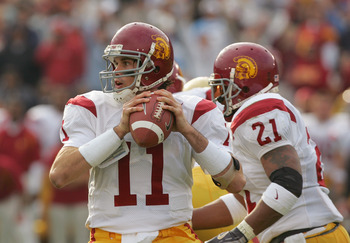 PASADENA, CA - DECEMBER 4:  Matt Leinart #11 of the USC Trojans sets to pass during the game against the UCLA Bruins on December 4, 2004 at the Rose Bowl in Pasadena, California.  USC won 29-24. (Photo by Harry How/Getty Images)