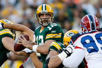 GREEN BAY, WI - AUGUST 22: Quarterback Aaron Rogers #12 of the Green Bay Packers drops back to pass the football against the Buffalo Bills at Lambeau Field on August 22, 2009 in Green Bay. Wisconsin.  (Photo by Scott Boehm/Getty Images)