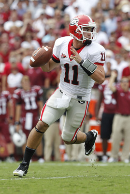 COLUMBIA, SC - SEPTEMBER 11: Quarterback Aaron Murray #11 of the Georgia Bulldogs rolls out and looks downfield to pass during the game against the South Carolina Gamecocks at Williams-Brice Stadium on September 11, 2010 in Columbia, South Carolina. The G