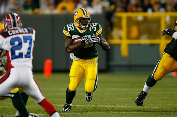 GREEN BAY, WI - AUGUST 22: Running back Brandon Jackson #32 of the Green Bay Packers runs with the football against the Buffalo Bills at Lambeau Field on August 22, 2009 in Green Bay. Wisconsin.  (Photo by Scott Boehm/Getty Images)