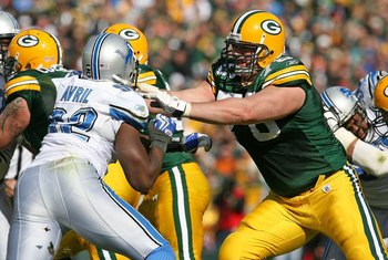 GREEN BAY, WI - OCTOBER 18: Chad Clifton #76 of the Green Bay Packers blocks Cliff Avril #92 of the Detroit Lions at Lambeau Field on October 18, 2009 in Green Bay, Wisconsin. The Packers defeated the Lions 26-0. (Photo by Jonathan Daniel/Getty Images)