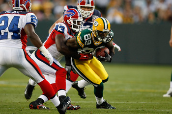 GREEN BAY, WI - AUGUST 22: Wide receiver James Jones #89 of the Green Bay Packers runs with the football after a pass reception against the Buffalo Bills at Lambeau Field on August 22, 2009 in Green Bay. Wisconsin. The Packers defeated the Bills 31-21. (P