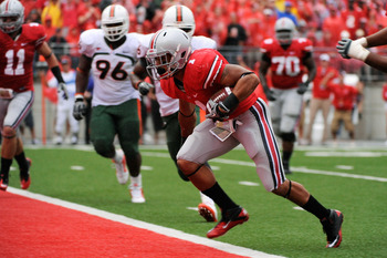 COLUMBUS, OH - SEPTEMBER 11:  Dan Herron #1 of the Ohio State Buckeyes scores a touchdown in the second quarter against the Miami Hurricanes at Ohio Stadium on September 11, 2010 in Columbus, Ohio.  (Photo by Jamie Sabau/Getty Images)