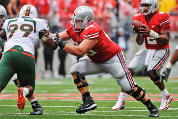COLUMBUS, OH - SEPTEMBER 11:  Justin Boren #65 of the Ohio State Buckeyes blocks against the Miami Hurricanes at Ohio Stadium on September 11, 2010 in Columbus, Ohio.  (Photo by Jamie Sabau/Getty Images)