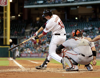 HOUSTON - JUNE 24:  Jason Casto #15 of the Houston Astros hits a home run to right field in the second inning against the San Francisco Giants at Minute Maid Park on June 24, 2010 in Houston, Texas.  (Photo by Bob Levey/Getty Images)