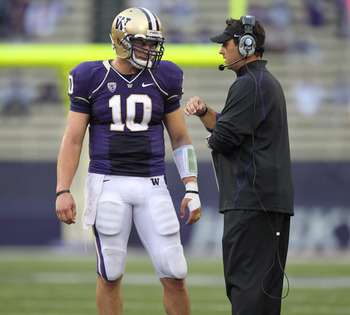 SEATTLE - SEPTEMBER 11:  Head coach Steve Sarkisian of the Washington Huskies talks with quarterback Jake Locker #10 during the game against the Syracuse Orange on September 11, 2010 at Husky Stadium in Seattle, Washington. (Photo by Otto Greule Jr/Getty