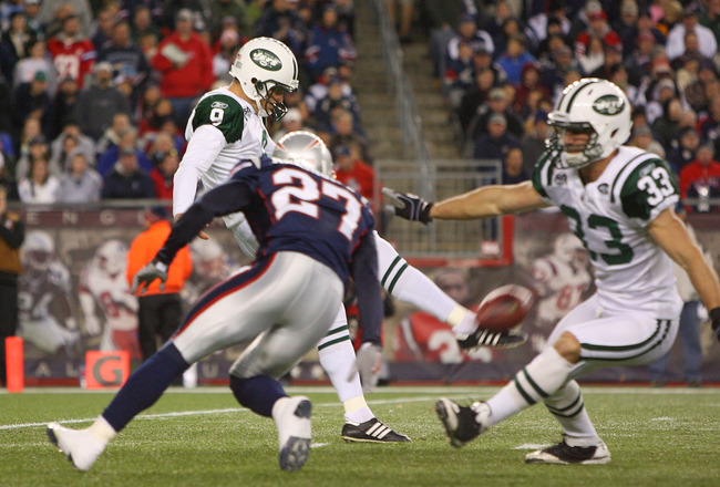 FOXBORO, MA - NOVEMBER 22: Kyle Arrington #27 of the New England Patriots presses punter  Steven Weatherford #9 of the New York Jets during a game against the New York Jets at Gillette Stadium on November 22, 2009 in Foxboro, Massachusetts. (Photo by Jim
