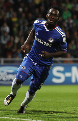ZILINA, SLOVAKIA - SEPTEMBER 15:  Michael Essien of Chelsea celebrates as he scores their first goal during the UEFA Champions League Group F match between MSK Zilina and Chelsea at the Pod Dubnom Stadium on September 15, 2010 in Zilina, Slovakia.  (Photo