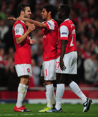 LONDON, ENGLAND - SEPTEMBER 15:  Carlos Vela of Arsenal celebrates with team mate Cesc Fabregas after scoring his teams sixth goal during the UEFA Champions League Group H match between Arsenal and SC Braga at the Emirates Stadium on September 15, 2010 in