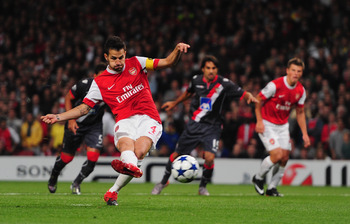 LONDON, ENGLAND - SEPTEMBER 15:  Cesc Fabregas of Arsenal scores from the penalty spot during the UEFA Champions League Group H match between Arsenal and SC Braga at the Emirates Stadium on September 15, 2010 in London, England.  (Photo by Mike Hewitt/Get