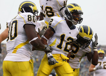 SOUTH BEND, IN - SEPTEMBER 11: Roy Roundtree #12 of the Michigan Wolverines celebrates a touchdown with teammates Martell Webb #80 and Vincent Smith #2 against the Notre Dame Fighting Irish at Notre Dame Stadium on September 11, 2010 in South Bend, Indian