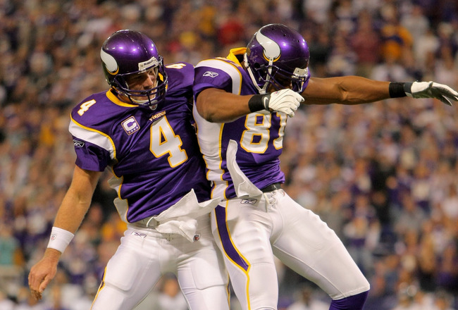 MINNEAPOLIS - OCTOBER 18:  Quarterback Brett Favre #4 celebrates his first quarter tocuhdown pass to wide receiver Visanthe Shiancoe #81 of the Minnesota Vikings against the Baltimore Ravens during NFL action at Hubert H. Humphrey Metrodome on October 18,