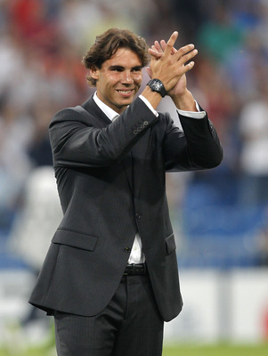 MADRID, SPAIN - SEPTEMBER 15: Tennis player Rafael Nadal greets prior to the start of the UEFA Champions League group G match between Real Madrid and AFC Ajax at Estadio Santiago Bernabeu on September 15, 2010 in Madrid, Spain. (Photo by Angel Martinez/Ge