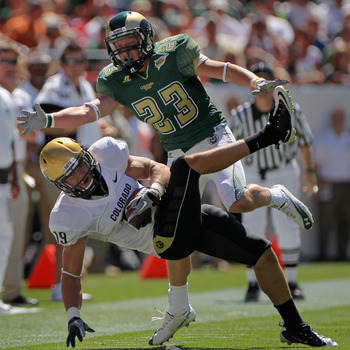 DENVER - SEPTEMBER 04:  Safety Travis Sandersfield #19 of the Colorado Buffaloes intercepts a pass intended for Tyson Liggett #23 of the Colorado State Rams during the the Rocky Mountain Showdown at INVESCO Field at Mile High on September 4, 2010 in Denve