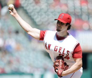 ANAHEIM, CA - SEPTEMBER 12:  Dan Haren #24 of the Los Angeles Angels of Anaheim pitches against the Seattle Mariners during the second inning at Angel Stadium on September 12, 2010 in Anaheim, California.  (Photo by Harry How/Getty Images)
