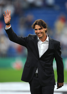 MADRID, SPAIN - SEPTEMBER 15: Rafael Nadal of Spain, the 2010 U.S. Open Champion, acknowledges the crowd prior to the start of the UEFA Champions League group G match between Real Madrid and Ajax at the Estadio Santiago Bernabeu on September 15, 2010 in M