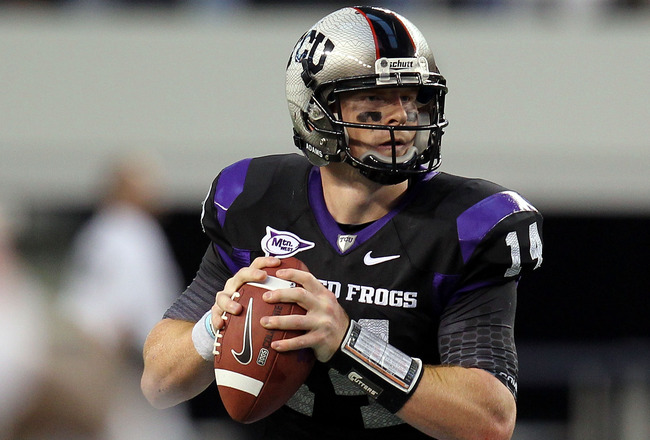 ARLINGTON, TX - SEPTEMBER 04:  Quarterback Andy Dalton #14 of the TCU Horned Frogs drops back to pass against the Oregon State Beavers at Cowboys Stadium on September 4, 2010 in Arlington, Texas.  (Photo by Ronald Martinez/Getty Images)