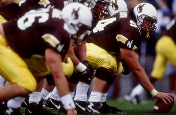 3 Oct 1998:  Scott Allmon #54 of the Wyoming Cowboys prepares to snap the ball during a game against the Utah Runnin'' Utes at the War Memorial Stadium in Laramie, Wyoming. The Cowboys defeated the Runnin'' Utes 27-24.