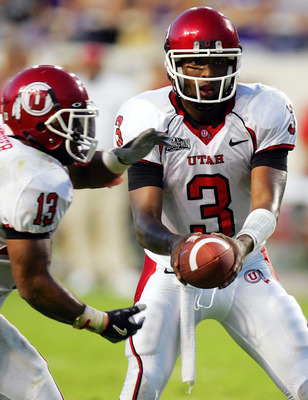 FORT WORTH, TX - SEPTEMBER 15:  Quarterback Brian Johnson #3 of the Utah Utes hands the ball to Quinton Ganther #13 during play against the Texas Christian University Horned Frogs on September 15, 2005 at Amon Carter Stadium in Fort Worth, Texas.  (Photo