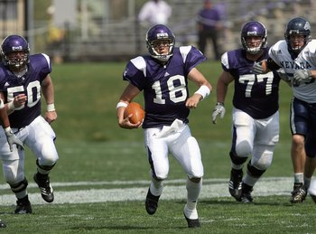 EVANSTON, IL - SEPTEMBER 8: Quarterback C.J. Bacher #18 of the Northwestern Wildcats runs the ball during the game against the Nevada Wolf Pack on September 8, 2007 at Ryan Field at Northwestern University in Evanston, Illinois. (Photo by Jonathan Daniel/