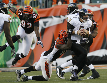 CINCINNATI - NOVEMBER 8: Carson Palmer #9 of the Cincinnati Bengals throws under pressure from the Baltimore Ravens at Paul Brown Stadium on November 8, 2009 in Cincinnati, Ohio.  (Photo by John Sommers II/Getty Images)