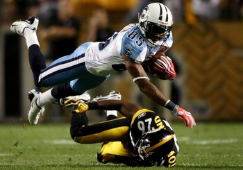PITTSBURGH - SEPTEMBER 10:  Wide receiver Nate Washington #85 of the Tennessee Titans catches a pass then tackled by Deshea Townsend #26 of the Pittsburgh Steelers during the second quarter of the NFL season opener at Heinz Field on September 10, 2009 in