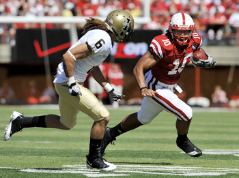 LINCOLN, NEBRASKA - SEPTEMBER 11: Nebraska Cornhuskers running back Roy Helu Jr. #10 runs past Idaho Vandals cornerback Aaron Grymes #6 during first half action of their game at Memorial Stadium on September 4, 2010 in Lincoln, Nebraska. Nebraska defeated