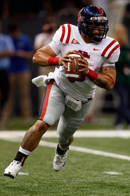 NEW ORLEANS - SEPTEMBER 11:  Jeremiah Masoli #8 of the Ole Miss Rebels looks to pass the ball against the the Tulane Green Wave at the Louisiana Superdome on September 11, 2010 in New Orleans, Louisiana.  Ole Miss defeated Tulane 27-13.  (Photo by Chris G