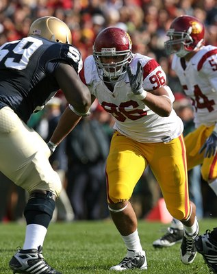 SOUTH BEND, IN - OCTOBER 17: Wes Horton #96 of the USC Trojans rushes against Chris Stewart #59 of the Notre Dame Fighting Irish at Notre Dame Stadium on October 17, 2009 in South Bend, Indiana. USC defeated Notre Dame 34-27. (Photo by Jonathan Daniel/Get