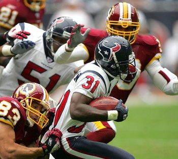 HOUSTON - SEPTEMBER 24:  Cornerback Phillip Buchanon #31 of the Houston Texans runs against the Washington Redskins on September 24, 2006 at Reliant Stadium in Houston, Texas. The Redskins defeated the Texans 31-15.  (Photo by Ronald Martinez/Getty Images