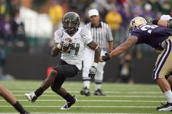 SEATTLE - OCTOBER 24: Kenjon Barner #24 of the Oregon Ducks carries the ball during the game against the Washington Huskies on October 24, 2009 at Husky Stadium in Seattle, Washington. The Ducks defeated the Huskies 43-19. (Photo by Otto Greule Jr/Getty I