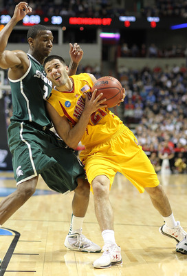 SPOKANE, WA - MARCH 21:  Greivis Vasquez #21 of the Maryland Terrapins drives against Raymar Morgan #2 of the Michigan State Spartans during the second round of the 2010 NCAA men's basketball tournament at the Spokane Arena on March 21, 2010 in Spokane, W