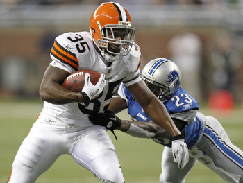 DETROIT - AUGUST 28:  Jerome Harrison #35 of the Cleveland Browns tries to escape the tackle of Chris Houston #23 of the Detroit Lions during preseason game on August 28, 2010 at Ford Field in Detroit, Michigan.  (Photo by Gregory Shamus/Getty Images)