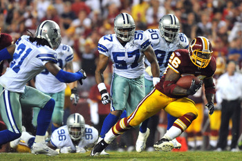 LANDOVER - SEPTEMBER 12:  Clinton Portis #26 of the Washington Redskins runs the ball during the NFL season opener against the Dallas Cowboys at FedExField on September 12, 2010 in Landover, Maryland. The Redskins defeated the Cowboys 13-7. (Photo by Larr