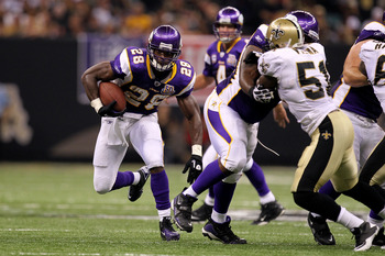NEW ORLEANS - SEPTEMBER 09:  Adrian Peterson #28 of the Minnesota Vikings runs the ball against the New Orleans Saints at Louisiana Superdome on September 9, 2010 in New Orleans, Louisiana.  (Photo by Ronald Martinez/Getty Images)