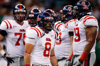 NEW ORLEANS - SEPTEMBER 11:  Jeremiah Masoli #8 of the Ole Miss Rebels looks to the sideline during a timeout against the Tulane Green Wave at the Louisiana Superdome on September 11, 2010 in New Orleans, Louisiana.  (Photo by Chris Graythen/Getty Images)