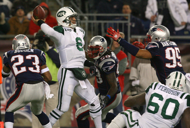 FOXBORO, MA - NOVEMBER 22:  Mark Sanchez #6 of the New York Jets feels the pressure of defense of the New England Patriots at Gillette Stadium on November 22, 2009 in Foxboro, Massachusetts. (Photo by Jim Rogash/Getty Images)