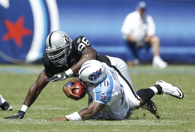 NASHVILLE - SEPTEMBER 12: Kamerion Wimbley #96 of the Oakland Raiders tackles Vince Young #10 of the Tennessee Titans during the NFL season opener at LP Field on September 12, 2010 in Nashville, Tennessee. The Titans defeated the Raiders 38-13. (Photo by