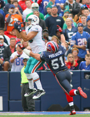 ORCHARD PARK, NY - SEPTEMBER 12:  Anthony Fasano # 80 of the Miami Dolphins makes a catch at the 2 yard line against Paul Posluszny #51 of  the Buffalo Bills during the NFL season opener at Ralph Wilson Stadium on September 12, 2010 in Orchard Park, New Y