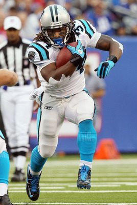EAST RUTHERFORD, NJ - SEPTEMBER 12:  DeAngelo Williams #34 of the Carolina Panthers runs the ball in the first half against the New York Giants on September 12, 2010 at the New Meadowlands Stadium in East Rutherford, New Jersey.  (Photo by Jim McIsaac/Get