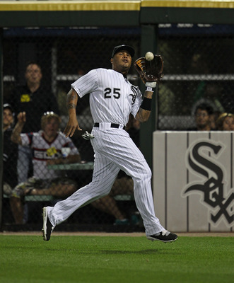 CHICAGO - AUGUST 25: Andruw Jones  #25 of the Chicago White Sox catches a fly ball against the Baltimore Orioles at U.S. Cellular Field on August 25, 2010 in Chicago, Illinois. The Orioles defeated the White Sox 4-3. (Photo by Jonathan Daniel/Getty Images